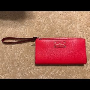 NWT - Red Kate Spade Wallet. Holds smartphone.